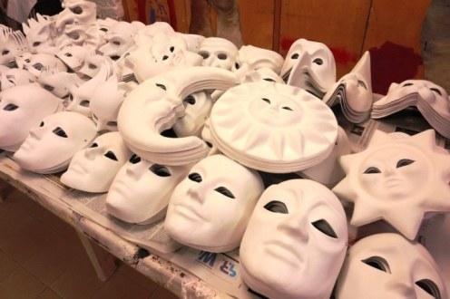 Various paper mache masks ready for decoration