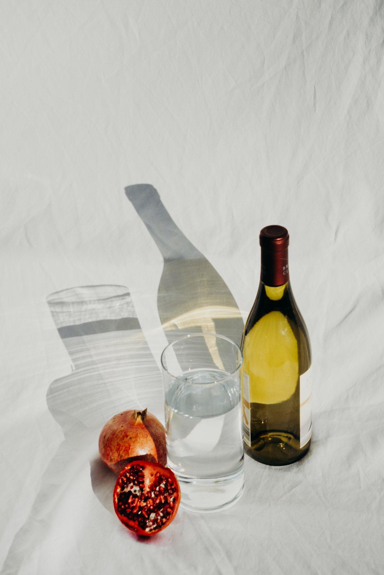 still life photography studio pomegranate wine shadows light shadows