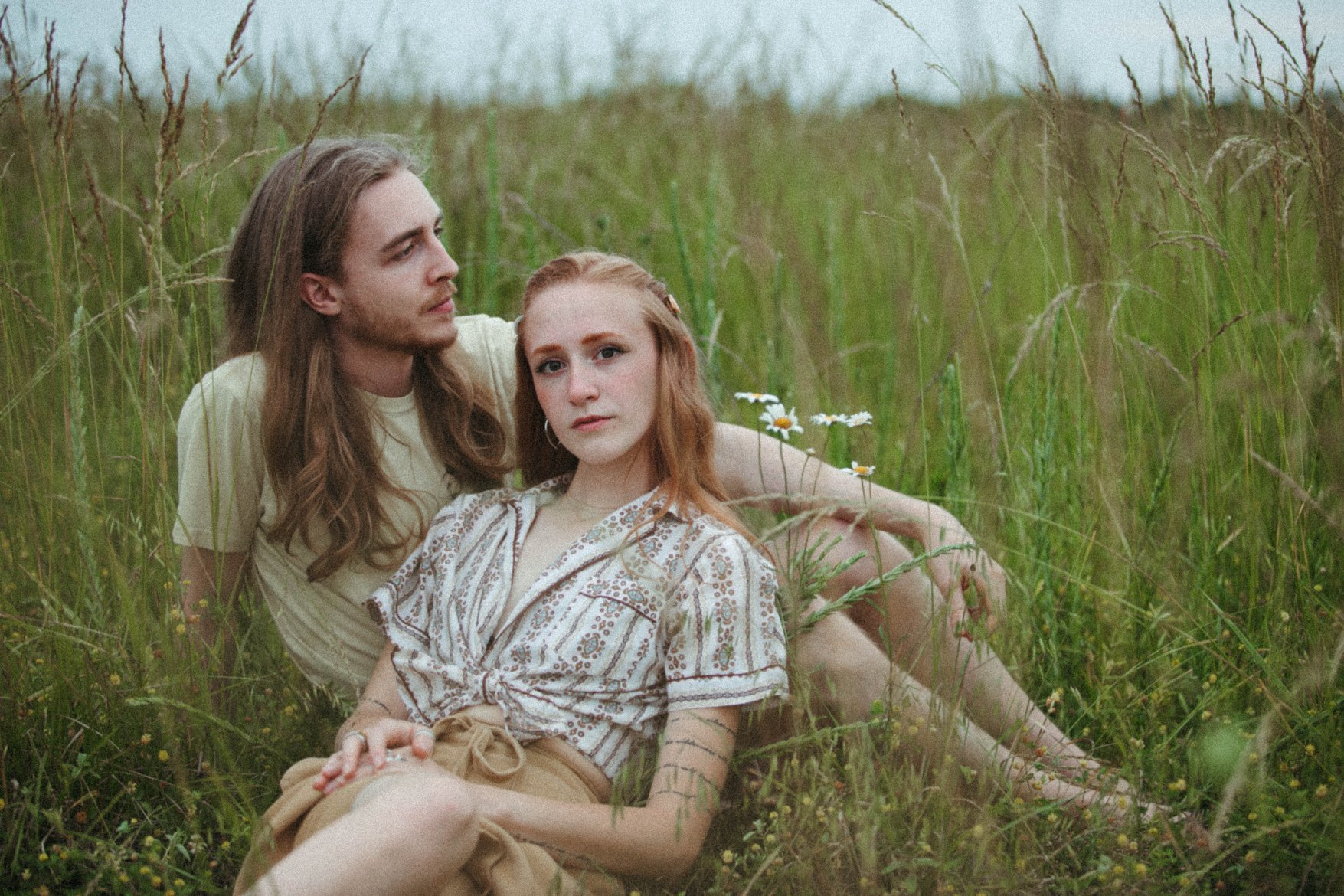 intimate couple photography love holding hands field prairie sunset romantic