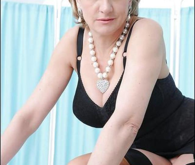 Mature Blonde Lady Sonia Poses In Her Sexy Black Stockings So Sexy