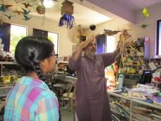 Arvind Gupta demonstrates one of his gazillion science toys.