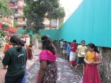 Dancing around the rangoli topped with gobbemmalu