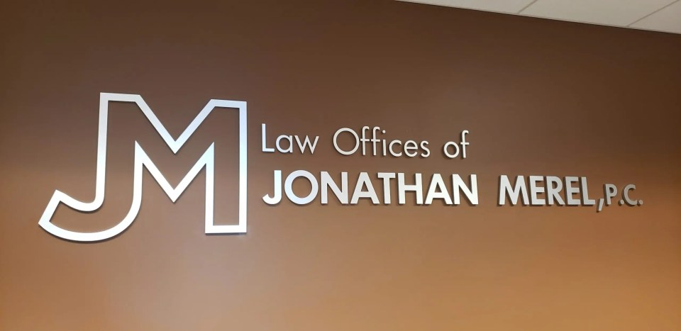Lobby sign a Jonathan Merel law firm