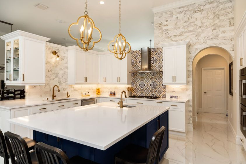 Beautiful luxury home kitchen with white cabinets.