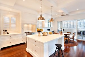 Attractive and beautiful kitchen having glossy wooden floor of a luxury house