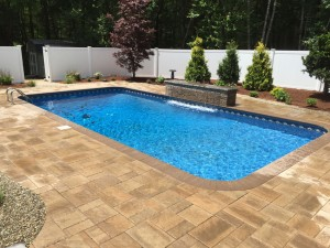 New pool with water feature - Pool Builder, Signature Pool and Spas in North Kingstown RI