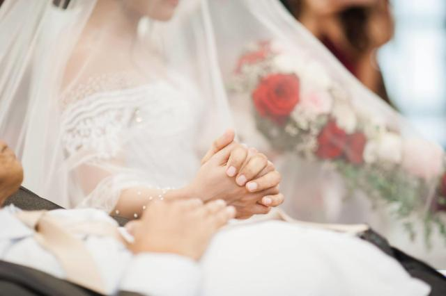 Unconditional love: Bedridden father 'walks' daughter down the aisle