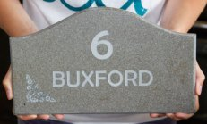 Shaped arch top house sign in Corian