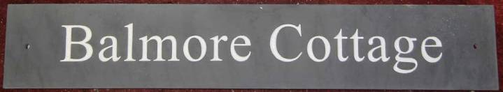 Slate sign with white letters