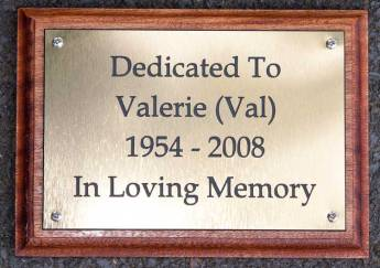 Brass effect acrylic memorial on backing board