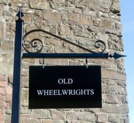 Maintenance free steel post and bracket with steel house sign