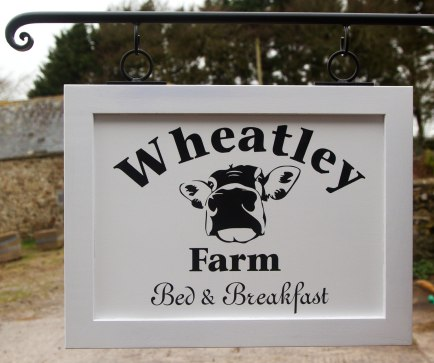Oak framed painted sign