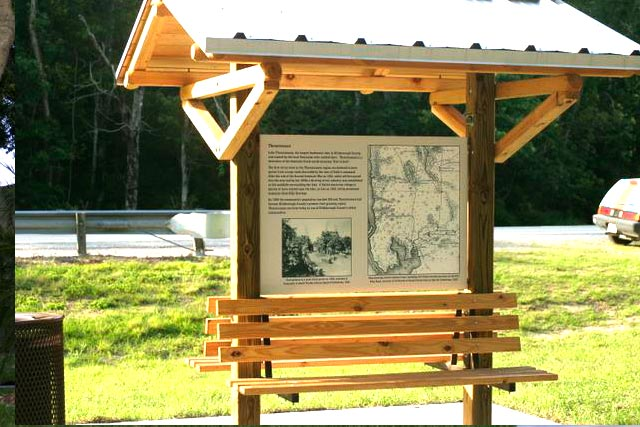 Informational Wooden Park Pole Sign with Bench and Awning