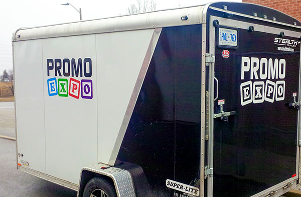 cargo trailer with vinyl advertisement and company logo