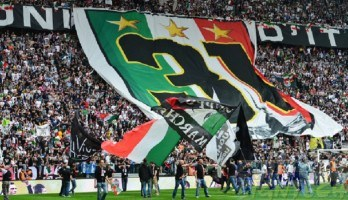 juventus soccer fans with flags