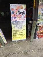 Put Up banner for Oasis Cafe