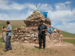 """""""You must always go around clockwise three times,"""" Baagii explained as he jumped out, shaking his wet hands to dry them. """"For a safe journey. It's like a shrine and it is symbolic of the open sky and Tengger, the sky spirit Genghis Khan prayed to before he came to power. Also makes good reference point,"""" he added, admitting that he knew this ovoo."""