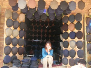 Maggie-the-Mom selling hats, China