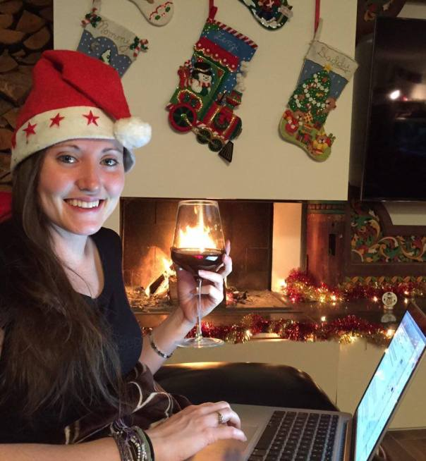 Enjoying this jolly season in the warmth of my own home with a glass of red wine.