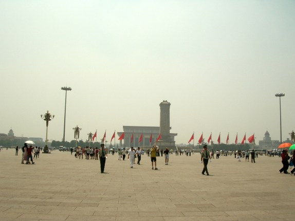 There was no doubt the square was huge. It was 440,000 m² (4,736,120ft²), almost as large as eighty football fields. A very large museum of history, Tiananmen Gate, an old railway station, and the Great Hall of the People made up the square's perimeter.
