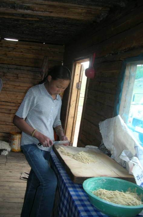 An older daughter in the Mongol family, probably around thirteen or so, was preparing noodles for dinner in the squishy kitchen. She kneaded the pale dough and then sliced and rolled it into very lumpy, uneven strips. It was not about presentation as much as it was about just getting it shaped into pieces that could be thrown into the soup.