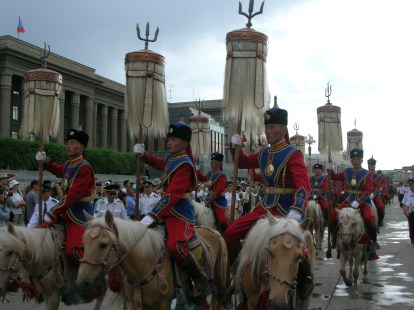 Sukhbaatar Square was full of onlookers as nine men, dressed in dazzling red and blue, super-hero-looking outfits and holding sacred horse tails, assembled in front of their horses and then mounted to parade around the city.