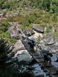 suspension bridges Himalayas, Nepal. Backpacks and Bra Straps