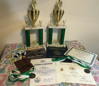 Lady B's Booty Trophies: Outstanding Orchestra Musician, Outstanding Choral Musician