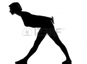 9799789-woman-exercising-fitness-yoga-stretching-in-shadow-grayscale-silhouette-full-length-in-studio-isolat