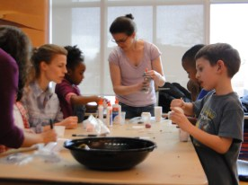 CHESS Postdoc Margaret Koker and Prof Silberstein help the GIAC kids make silly putty.