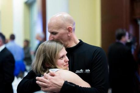 Dave Fortier of Newburyport, who suffered hearing damage in both ears, embraced Elizabeth Bermingham, a fellow bombing survivor.