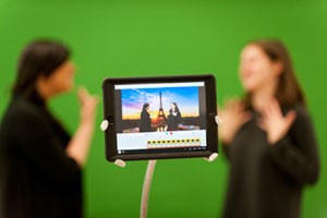 Photo of iPad with recorded session of students using sign language