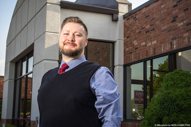 Adam Christensen helps manage Easter Seals Midwest, a nonprofit that recently relocated.