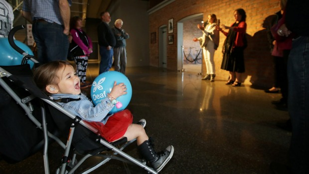 Lourdes Gerrard, 2, of Invercargill, clutches her balloon during a tour of Bill Richardson Transport World on Friday.