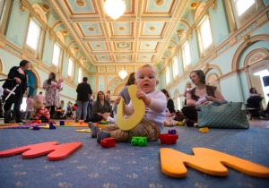 Eight-month-old James Koops joins 160 mums at Government House who have recently given birth at the Royal Women's Hospital.