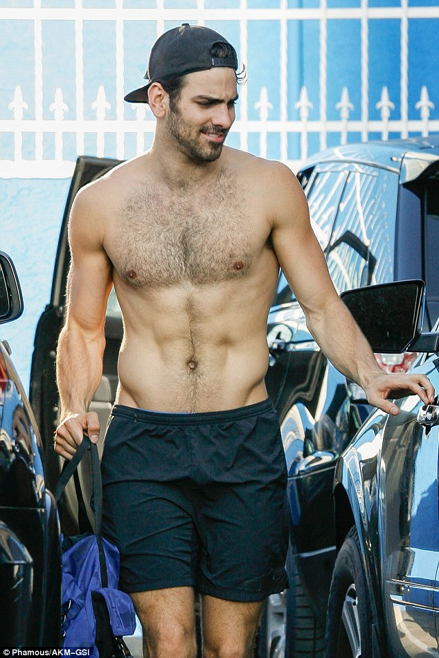 Eye candy: 27-year-old heartthrob Nyle DiMarco flashed his six-pack abs along with a satisfied grin as he walked out and got into a car