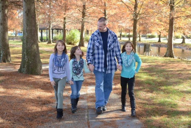 Michael Hubbard with walking with his three daughters.