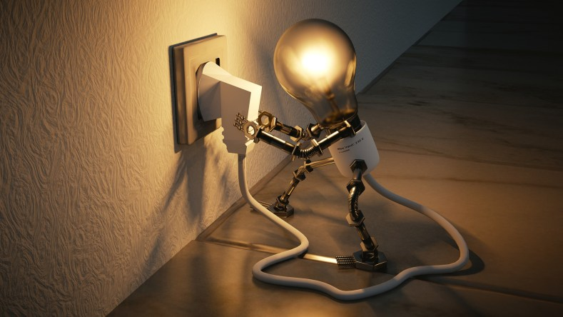 A light bulb plugging itself in the electric socket.
