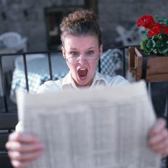 Angry Woman Reading Paper
