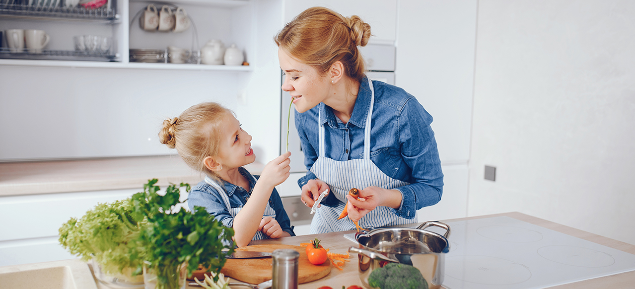 Mother and child cooking together