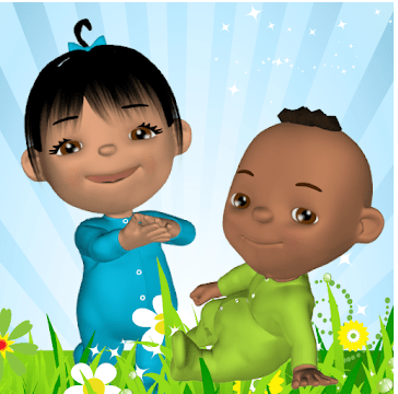 A small girl wearing a blue onesie is smiling and standing next two a small boy in a green onesie who is sitting down in the grass
