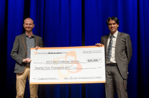 BioAesthetics founder Nick Pashos accepting his $25,000 check after winning the 2015 BioChallenge.