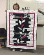 Melba shows us her awesome black and white quilt! We love the applique detail.