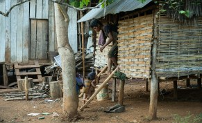 small village along the road, tribal people work for plantations