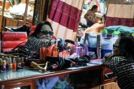 Beauty is everywhere at the local market - women come and shop and get their personal maintenance done