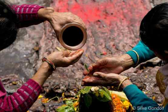Puja with holy milk from Kathmandus Pashupatinath Temple