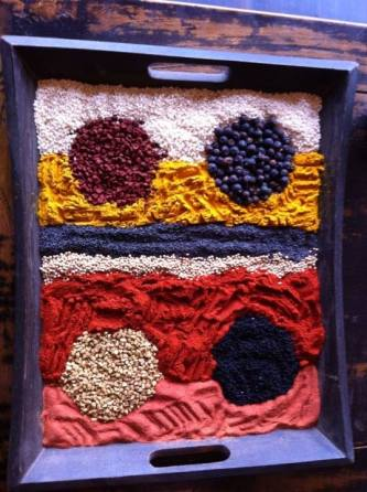 We use guides to help make perfect circles and other shapes. This one has white poppy seeds, turmeric, black poppy seeds, yellow mustard seeds, paprika, tomato powder, annatto seeds, juniper berries, fenugreek seeds and nigella seeds.