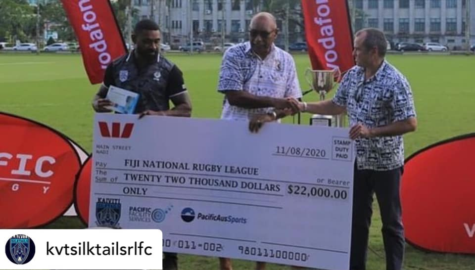 Handover of the $22K cheque from DFAT to FNRL