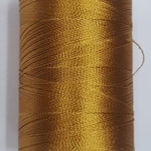 Gold colour silk thread spool