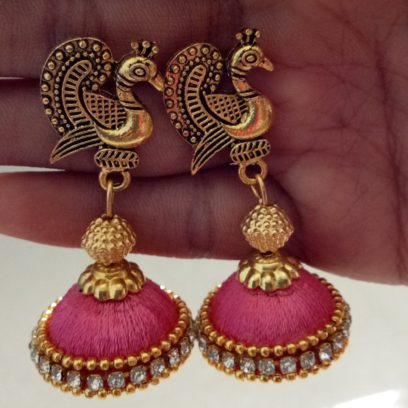 82df330a6 250.00₹ 200.00₹. Pink silk thread peacock stud Jhumkas. Product Code:  SumithraCre01